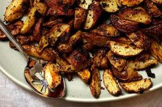 mustard roasted potatoes by smitten kitchen -- made these tonight, my pals couldn't stop eating them and made off with the recipe. YUM.
