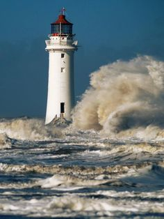 Lighthouse completely surrounded by the sea...