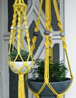 Macrame - love the colours against the green plants