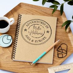 Perfect bound notepad with a natural cover made from 100% recycled cardboard and approximately 75 sheets of 80gsm 100% recycled plain white paper.The print is in black ink and in uppercase lettering as shown.21cm x 14.5cm (A5)