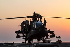 Soldiers from the 4th Battalion (Attack Reconnaissance), 227th Aviation Regiment perform maintenance on an AH-64D Apache helicopter at the end of the day while on board the USS Ponce in the Arabian Gulf. The battalion, from the 1st Cavalry Division at Fort Hood, is the newest addition to the 36th Combat Aviation Brigade (36th Infantry Division). (U.S. Army photo by Sgt. Mark Scovell)