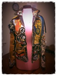 Welcome to my shop. I make art in the form of one of a kind, hand made jackets. This particular jacket took 2 years to make, and there is nothing