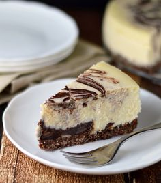Creamy coconut cheesecake over a chocolate macaroon crust. Swirled with chocolate, of course!