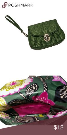 Vera Bradley Puffy Wristlet in Olivia Pink Puffy Material in Olivia Green. Olivia Pink inside pattern. Pushlock Closure. Removable wristlet Strap. One card slot inside. Wipe Clean.  Gently Used Vera Bradley Bags Clutches & Wristlets