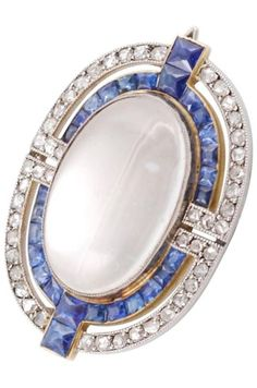 Cartier Paris, Art Deco Brooch in platinum 850, 18k gold 750, rose cut diamond, calibrated sapphire and centred by a cabochon moonstone, circa 1930. Signed Cartier Paris, numbered, French marks. #Cartier #ArtDeco #brooch