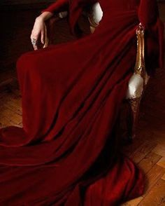 Scarlet robes, studded with the jewels of every soul she claimed. Vaneer