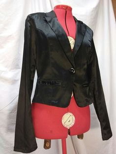 6109620caffc7 Shiny black blazer jacket from Ashley by 26 International With two faux  pockets V neckline with