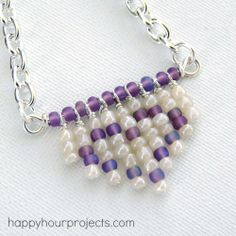 DIY Beginner Heart Fringe Necklace Tutorial from Happy Hour Projects here.You could also skip the spacer beads at the top (the straight wire) and just use safety pins instead of headpins - just make sure the beads fit on them.