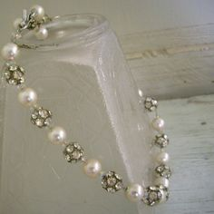 A fabulous rhinestone and pearl bead necklace that will turn every head in the room