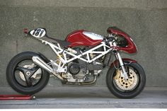 Techinical Schedule:   -Modified frame  -Ducati Monster S2R single side swing arm  -RAD 02 Montjuich alum...