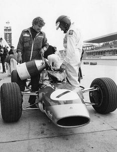 Clark's last race. Driving the Formula 2 Lotus 48, he was unhappy with the handling of the car and spun twice in practice. Here Clark helps re-fuel the Lotus right before the start of the 1968 F2 race at Hockenheim.