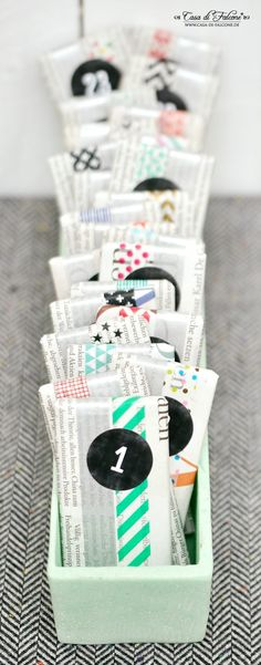 Newspaper and washi tape.