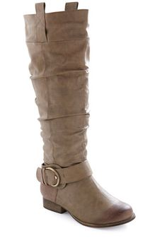 Follow My Steed Boot    Rustling up fun is never a fuss when youre wearing this handsome boot! Created from vegan faux leather in a sturdy shade of medium brown this boot spurs interest wherever you strut with its antiqued brass buckle detail at your ankle classic calf-high silhouette and versatile short heel.  $64.99