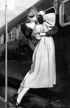 April 27, 1952: Returning Korean War soldier Sgt. 1st Class Owen Marsh of North Hollywood leans out a bus window to kiss his wife, Evelyn.