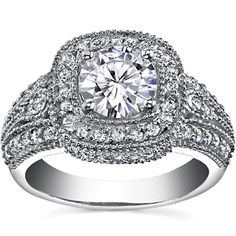 8mm center stone/white gold $2075.00 Round Moissanite Antique Halo. THIS IS MY ENGAGEMENT RING!!!!