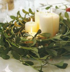 Wreath used as a centrepiece with candles for Christmas