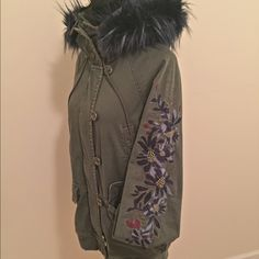 Free People Follow Me Close Parka Army green utility coat with removable fur trim hood. Beautiful embroidery embellishment. Stretchy, banded hem and cuffs, quilted lining, and zip and button closures.98% Cotton, 2% Spandex. Bust: 43 1/2 in = 110 1/2 cm. Length: 30 3/4 in = 78 cm. Sleeve Length: 29 in = 73 3/4 cm Free People Jackets & Coats