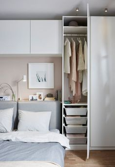 Learn how you can create a living room, bedroom, dining room and office all in one space. Our team at IKEA designed a living space in a small room using furniture such as a modular sofa bed, a tiny wardrobe, shelving units and a few high cabinets. Closet Bedroom, Home Bedroom, Bedroom Decor, Bedroom Ideas, Bedroom 2018, Budget Bedroom, Bedroom Ceiling, Bedroom Inspo, Bedroom Apartment