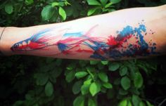 Watercolor Abstract Tattoos With Fish Moving In Water