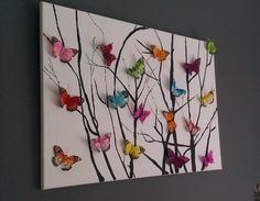 Beautiful butterfly artwork. 3D buttetflies glued on and sticks done either painted on or painted sticks and then imprint onto canvas.