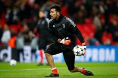 Gianluigi Buffon of Juventus warms up prior to the UEFA Champions League Round of 16 Second Leg match between Tottenham Hotspur and Juventus at Wembley Stadium on March 7, 2018 in London, United Kingdom. - 24 of 110