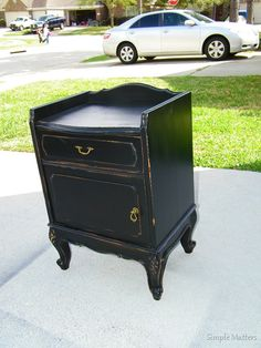 Black distressed french accent table