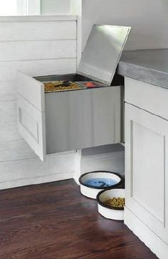 Built-in bin for pet food and supplies.  #ClippedOnIssuu from Atlanta Homes & Lifestyles January 2015 issue