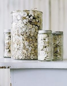 neutral buttons in jars   this reminds me of my Mother