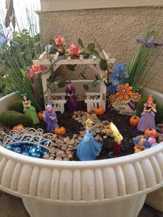 20140414-220913.jpg...my Disney themed fairy gardens I created....lindy'slist.net....Cinderella themed garden scene.