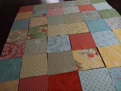 laying out the charm squares by retro mummy, via Flickr
