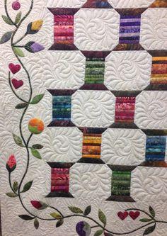"""Spool Quilt"" design by Edyta Sitar.  Beautifully made by Dianne Civak of The Quilting Bee.  Custom long arm machine quilting by Kelly Corfe."