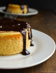 Bourbon Cheesecake with Boozy Chocolate For Two are creamy cheesecakes covered in spiked hot fudge. This recipe makes 2 little cheesecakes; a perfect sweet treat for two. Romantic Desserts, Just Desserts, Cheesecake Recipes, Dessert Recipes, Alcohol Cake, Dessert For Two, Savoury Cake, Cheesecakes, Sweet Tooth