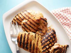 Rachael Ray coats juicy chicken pieces in a mixture of brown sugar, honey mustard, allspice and curry for sweet-spicy flavor and then grills the chicken to smoky-charred perfection.