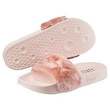 The Fur Slide, the third style unleashed from the FENTY PUMA by Rihanna collection is a daring, cozy spin on a PUMA classic. A make-over of a timeless PUMA performance sandal worn by soccer players off the field, its soft, comfortable design features a faux fur strap and a satin foam backing. Features:   Faux fur strap   Satin foam strap backing   FENTY PUMA by Rihanna logo at footbed   PUMA No. 1 Logo at lateral side   Embroidered PUMA No. 1 Logo at strap   This product has a larger fit…