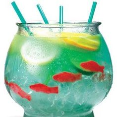 "Alcohol...SUMMER DRINK! ½ cup Nerds candy ½ gallon goldfish bowl 5 oz. vodka 5 oz. Malibu rum 3 oz. blue Curacao 6 oz. sweet-and-sour mix 16 oz. pineapple juice 16 oz. Sprite 3 slices each: lemon, lime, orange 4 Swedish gummy fish Sprinkle Nerds on bottom of bowl as ""gravel."" Fill bowl with ice. Add remaining ingredients. Serve with 18-inch party straws."