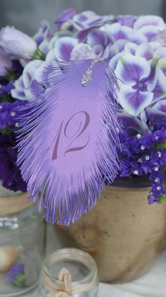 Wedding Table Numbers FEATHER's in Purple plum text by liradesigne