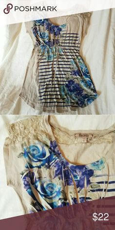 Cream with blue floral print tunic t-shirt euc s Cream colored t-shirt with beautiful blue floral print and Stripes. Cute lace detailing size small, by decree. Gently worn euc. Decree Tops Tunics