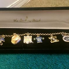 """Seattle Seahawks Charm Bracelet Seahawk fans are going to love this beautiful charm bracelet from  the Danbury Mint.  This bracelet is 24kt      f2f gold,-plated with Austrian crystals and colored  enamels. It has 7 charms: The Seshwk logo, Stadium, a football, a helmet and more! It measures 7 1/2"""".  This has been worn twice.  They do not offer this bracelet anymore. I paid $104.00and the condition is new.  Serious offers only Jewelry Bracelets"""