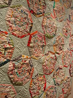 spiderweb quilt made of selvages--incredible quilting too