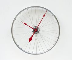 Recycled Bike Wheel clock #DIY #industrial - Really wana make me one of these, maybe have to use a fold up bike wheel though!