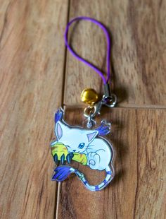 1.5 inch one sided clear acrylic charm of Gatomon from Digimon. Can be used as a phone charm or zipper pull. Comes with jump ring and phone strap/dust plug/keychain options.