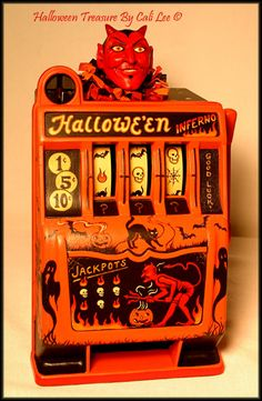 Halloween Inferno!  A slot machine with a firey theme~ including a hand sculpted devil topper. by Cali Lee