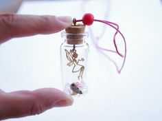 Gift for Bridesmaids!  Tinkerbell necklace, bottle necklace, summer 2012, magenta, fuchsia, free shipping, Peter Pan. $28.00, via Etsy.