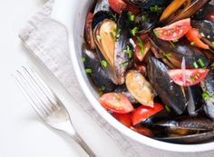Mussels tomatoes and French wine