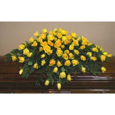 YELLOW ROSE CASKET SPRAY - This is pretty much what Mom's spray looked like. 100 yellow roses, her favorite flower.