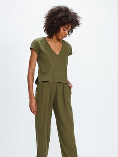 d5768a30bf2a Short sleeve cropped v-neck top in olive green raw silk. Made in India Silk  Dry clean Fits true to size.