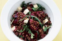 1/4 cup olive oil  1 red onion, chopped  2 garlic cloves, crushed  2 x 400g cans brown lentils, drained, rinsed  450g can beetroot wedges, drained  1 tablespoon red wine vinegar  80g baby rocket leaves  180g feta cheese, cut into cubes