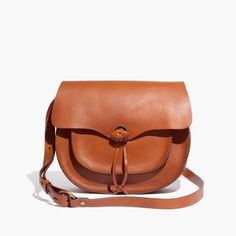 In smooth, substantial leather with oversized stitches, this saddlebag has a bit of a vintage vibe. With an adjustable crossbody strap and hand-knotted details, it has the rugged-meets-cool thing down.