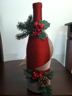 christmas decorations adorn tap wine bottle