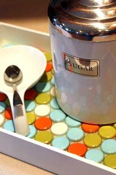 bottle cap tray - cute as a breakfast tray. Paint over the caps to create a uniform look.